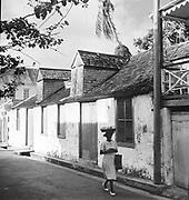 Walking down the street.<br /> West Indies.