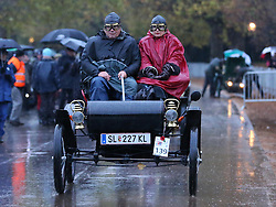 A cold wet start for the drivers of a 1902 Oldsmobile as it leaves Hyde Park in London at the start of the London to Brighton Veteran Car Run Sunday  4th November 2012.     Photo by: Stephen Lock / i-Images