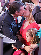 Republican presidential candidate Ted Cruz kiss his wife Heidi while holding on to his children Caroline and Cathorine  before speaking to supporters at his election night party after Super Tuesday in Stafford, Texas, USA, 01 March 2016. Twelve states voted in the early primary on Super Tuesday across the country.