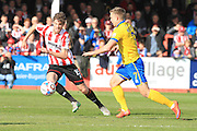 Cameron Burgess and Jack Moulden during the Vanarama National League match between Cheltenham Town and Lincoln City at Whaddon Road, Cheltenham, England on 30 April 2016. Photo by Antony Thompson.