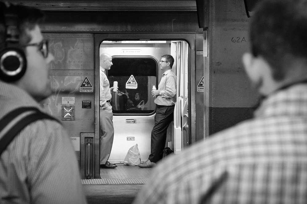 A couple of commuters converse while awaiting for the train to depart from New York Penn Station.