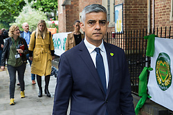 London, UK. 14 June, 2019. Mayor of London Sadiq Khan arrives to attend a memorial service at St Helen's Church to mark the second anniversary of the Grenfell Tower fire on 14th June 2017 in which 72 people died and over 70 were injured.