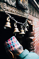 A man walks through the entryway at Mahaboudha Temple in Patan.