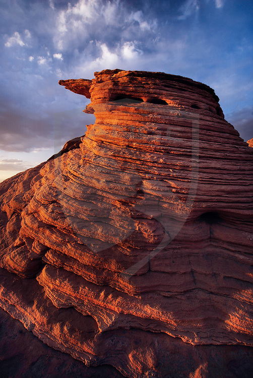 nature scenery and travel destinations: glen canyon national recreation area peaceful abstract red sandstone rock formation (the beehives region) landscape sunset, arizona, vertical, copy space