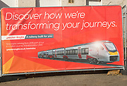 Greater Anglia advertising banner about new trains for the railway in 2019, Saxmundham station, Suffolk, England, UK