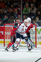 KELOWNA, BC - MARCH 09: Roman Basran #30 defends the  net as Kyle Crosbie #25 of the Kelowna Rockets back checks Martin Lang #22 of the Kamloops Blazers  at Prospera Place on March 9, 2019 in Kelowna, Canada. (Photo by Marissa Baecker/Getty Images)