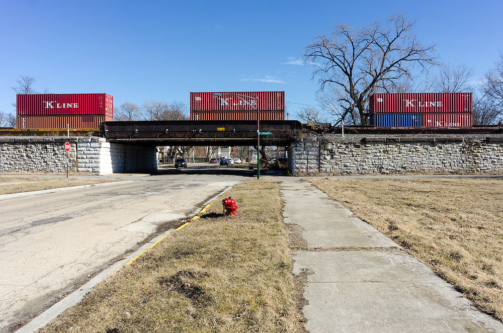 On February 19th, a freight train rolls by the the largely vacant 84-acre site Norfolk Southern is using to expand its intermodal rail yard.