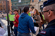 """Roma 23 Maggio 2015<br /> Veglia del movimento Sentinelle in piedi, in piazza San Silvestro,  in favore della famiglia """"tradizionale"""" e contro le Unioni Civili e i matrimoni gay, le persone che hanno partecipato alla veglia  sono rimaste in piedi in silenzio, per un'ora, leggendo un libro. Un gruppo  di attivisti Lgbt ha contestato la manifestazione. Un addetto alla vigilanza delle veglia (giubetto azzurro) aggredisce i manifestanti.<br /> Rome May 23, 2015<br /> Vigil of the movement Sentinels standing in Piazza San Silvestro, in favor of """"traditional"""" family and against civil unions and gay marriage,  people who participated in the vigil were left standing in silence for an hour, reading a book. A group of LGBT activists challenged the event. A security guard of the vigil (blue vests) attack protesters"""