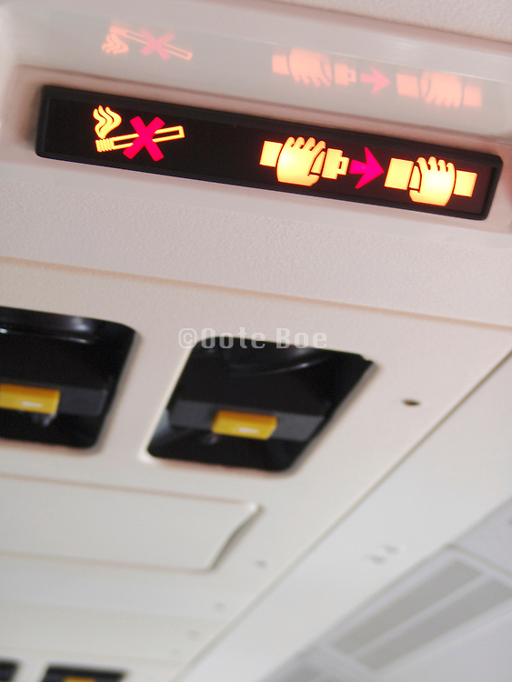 No smoking and seat belt safety light lighted up in airplane