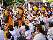 26 JANUARY 2013 - BANGKOK, THAILAND:  Buddhist monks start Saturday's leg of their mass pilgrimage through Bangkok at Surasakmontri School. 1,128 Buddhist monks from the Dhammakaya movement took part in a 25-day pilgrimage walk passing through Bangkok and several provinces in central Thailand, as part of a voluntarily undertaking of ascetic practices. The pilgrimage is scheduled to end Sunday, January 27 at Wat Phra Dhammakaya near Bangkok. Along the way Thai Buddhists laid marigolds along their path and greeted them for merit making. The Dhammakaya is the fastest growing Buddhist movement in Thailand. The pilgrimage is reported to be the largest pilgrimage in Thailand and organizers hope to get it placed in the Guiness World Records book.     PHOTO BY JACK KURTZ
