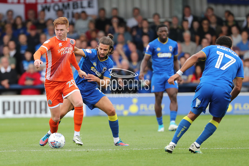 AFC Wimbledon defender George Francomb (7) battles for possession with Shrewsbury Town midfielder Jon Nolan (20) during the EFL Sky Bet League 1 match between AFC Wimbledon and Shrewsbury Town at the Cherry Red Records Stadium, Kingston, England on 12 August 2017. Photo by Matthew Redman.