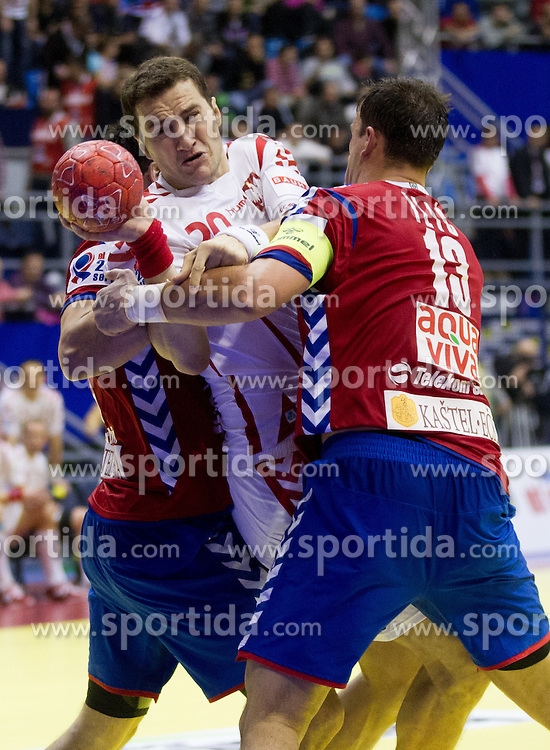 Mariusz Jurkiewicz of Poland between Nenad Vuckovic  of Serbia and  Momir Ilic  of Serbia during handball match between Poland and Serbia in Preliminary Round of 10th EHF European Handball Championship Serbia 2012, on January 15, 2012 in Arena Pionir, Belgrade, Serbia. Serbia defeated Poland 22-18. (Photo By Vid Ponikvar / Sportida.com)