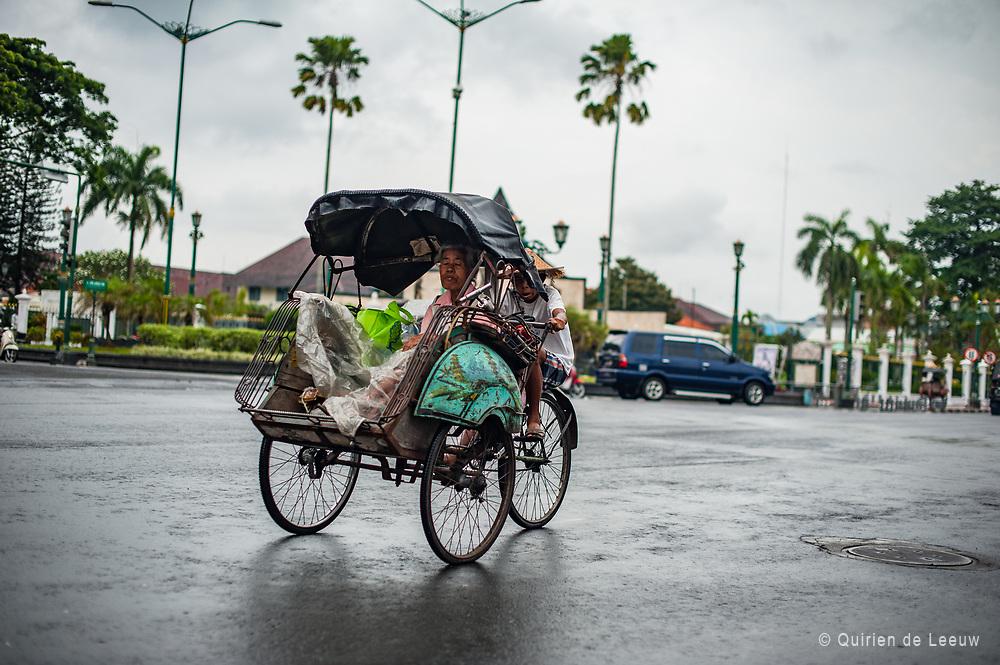 Woman and child on a rickshaw bike, Yogyakarta, Java Indonesia
