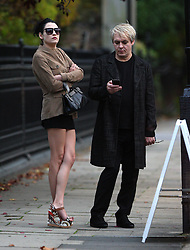 Duran Duran star Nick Rhodes and his younger girlfriend Maria Suvio wearing a brown jacket, short black skirt showing of her perfect pins and a pair of wedge shoes. The pair were spotted in Regents Park waiting for their chauffeur. London, UK. 09/10/2012<br />BYLINE MUST READ : GOTCHAIMAGES.COM<br /><br />Copyright by © Gotcha Images Ltd. All rights reserved.<br />Usage of this image is conditional upon the acceptance <br />of Gotcha Images Ltd, terms and conditions available at<br />www.gotchaimages.com