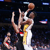 26 March 2016: Los Angeles Lakers guard David Nwaba (10) goes for the jump shot over Portland Trail Blazers guard CJ McCollum (3) during the Portland Trail Blazers 97-81 victory over the Los Angeles Lakers, at the Staples Center, Los Angeles, California, USA.