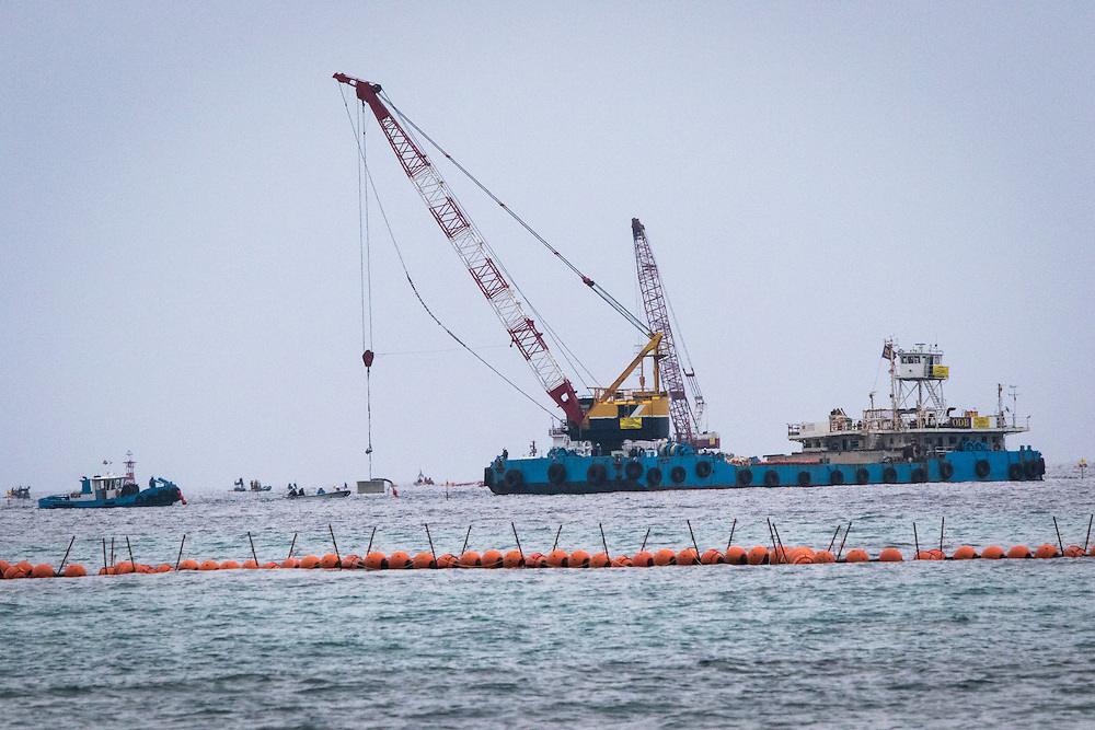 OKINAWA, JAPAN - FEBRUARY 8 :  Workers were seen  concrete blocks from barges before dropping into the sea during construction work for the relocation of U.S. Marine Corps Air Station Futenma on February 8, 2017 in Nago, Okinawa prefecture, Japan. Japan's government started offshore construction work Monday on relocating a U.S. Marine base in Okinawa. (Photo by Richard Atrero de Guzman/NURPhoto)