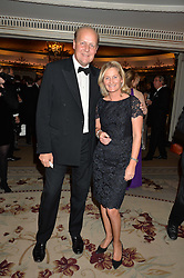Racehorse trainer EDWARD DUNLOP and his wife REBECCA at the 26th Cartier Racing Awards held at The Dorchester, Park Lane, London on 8th November 2016.