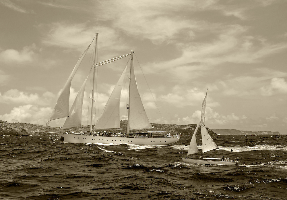 Chronos a 157 ft Staysail Ketch, and<br /> <br /> <br /> Back in the 60s, classic yachts, which were gathered in English Harbour Antigua, had begun chartering and the captains and crews challenged each other to a race down to Guadeloupe and back to celebrate the end of the charter season. From this informal race, Antigua Race Week was formalised in 1967, and in those days all of the yachts were classics. As the years grew on, the classic yachts were slowly outnumbered but the faster sleeker modern racing yachts and 24 years later the Classic Class had diminished to a few boats and was abandoned in 1987. However this same year seven classic yachts turned out and were placed in Cruising Class 3 with the bare boats. The class was so unmatched that it was downright dangerous, so Captain Uli Pruesse hosted a meeting onboard Aschanti of Saba with several classic skippers and in 1988 the Antigua Classic Yacht Regatta was born, with seven boats.<br /> <br /> In 1991, Elizabeth Meyer brought her newly refitted Endeavour and Baron Edmond Rothschild brought his 6-meter Spirit of St Kitts and &ldquo;CSR&rdquo; became the first Sponsor and inaugurated the Concours d&rsquo;El&eacute;gance. In 1996 we created the &ldquo;Spirit of Tradition Class&rdquo;, which has now been accepted all over the world, which gives the &ldquo;new&rdquo; classics, built along the lines of the old, a chance to sail alongside their sister ships. In 1999 we celebrated the first race between the J class yachts in 60 years. Mount Gay Rum has sponsored the Regatta for many years, and we have recently added Officine Panerai as our first ever Platinum Sponsor.<br /> <br /> The Antigua Classic Yacht Regatta has maintained a steady growth, hosting between 50 and 60 yachts every year and enjoys a wonderful variety of competitors, including traditional craft from the islands, classic ketches, sloops, schooners and yawls making the bulk of the fleet, together with the stunningly beautiful Spirit of Tradition yacht