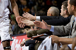 Coaches and players welcome Virginia forward Jamil Tucker (12) back to the bench.  The Virginia Cavaliers men's basketball team defeated the Elon Phoenix 91-61  at the John Paul Jones Arena in Charlottesville, VA on December 22, 2007.