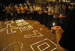 Malaysians gather during a candlelight vigil for passengers onboard the missing Malaysia Airlines Flight MH370 in Kuala Lumpur,  Malaysia early on April 8, 2014. Candlelight vigil for the 239 people on board missing Malaysia Airlines flight MH370  marking a month since the plane disappeared on 8  March 08 2014, <br /> Tuesday, 8th April 2014. Picture by Mohd FIrdaus / i-Images