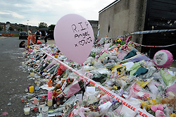 © Licensed to London News Pictures. 15/08/2012 .Tia Sharp's memorial of flowers is steadily growing today(15/08/2012) as Tia's Step Grandfather appears at the Old Bailey by video link charged with her murder.  The Lindens in New Addington on the Fieldway Estate..Photo credit : Grant Falvey/LNP