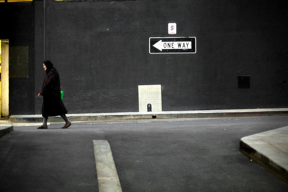 Old woman walking in street