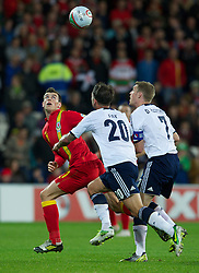CARDIFF, WALES - Friday, October 12, 2012: Wales' Gareth Bale in action against Scotland during the Brazil 2014 FIFA World Cup Qualifying Group A match at the Cardiff City Stadium. (Pic by David Rawcliffe/Propaganda)
