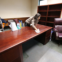 Dee Eleopoulos gets the desk ready to be moved to their new location along with other items as they begin renovations of the third floor of the Lee County Justice Center for the new judges.