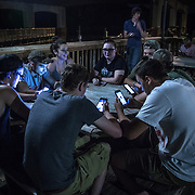 OCCOQUAN, VA - AUG4: Teenagers play Pokemon Go in Occoquan, Virginia, August 4th, 2016. This sleepy Virginia town has become a hotspot for Pokemon Go. Throughout the night, kids and young adults play the game on the streets, leaving beer bottles and litter behind. A few residents have complained to city hall and now the city is hiring extra police officers to handle the new masses. (Photo by Evelyn Hockstein/For The Washington Post)
