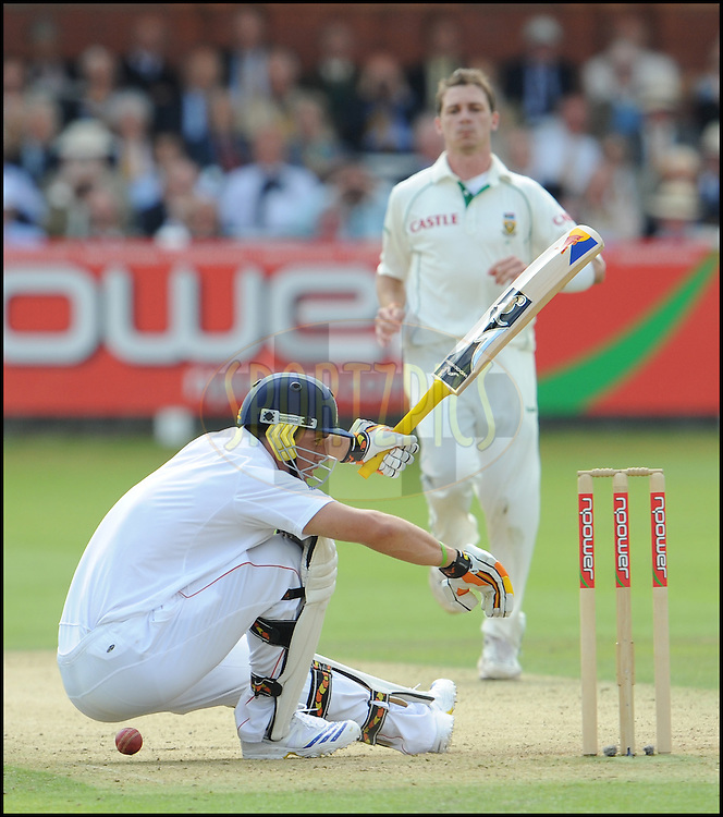 Kevin Pietersen of England is hit on the helmet by Dale Steyn of South Africa and the ball almost goes onto the stumps at Lord's on the first day of the first Test on the 10th of July 2008..England v South Africa.Photo by Philip Brown.www.philipbrownphotos.com