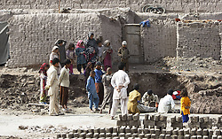 Children work at a brick factory in Nangarhar province, eastern Afghanistan, on Feb. 11, 2013. The child labor has remained rampant in brick kiln industry of the country., Monday February 11, 2013. Photo by Imago / i-Images. UK ONLY..