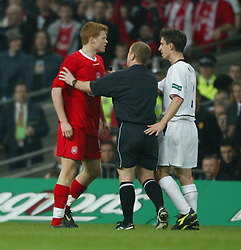 CARDIFF, WALES - Sunday, March 2, 2003: Referee Paul Durkin steps in to seperate Liverpool's John Arne Riise and Manchester United's Gary Neville and Roy Keane during the Football League Cup Final at the Millennium Stadium. (Pic by David Rawcliffe/Propaganda)