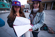 Naomi (16) and Paola (17)  waiting since one week for the concert of Justin Bieber and showing the list of the groups in order of arrivals at the Palacio de los deportes in Madrid