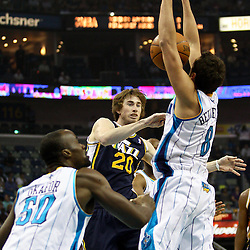April 11, 2011; New Orleans, LA, USA; Utah Jazz small forward Gordon Hayward (20) has his pass stolen by New Orleans Hornets shooting guard Marco Belinelli (8) during the first half at the New Orleans Arena.  Mandatory Credit: Derick E. Hingle