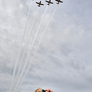 Jan Zumer-Brewis, 4, holds onto his sunglasses while watching Canada's Snowbirds acrobatic team fly in formation during the Royal Canadian Air Force show at the Erik Nielsen International airport in Whitehorse, Canada.<br /> <br /> &copy;2012 Ian Stewart Photography