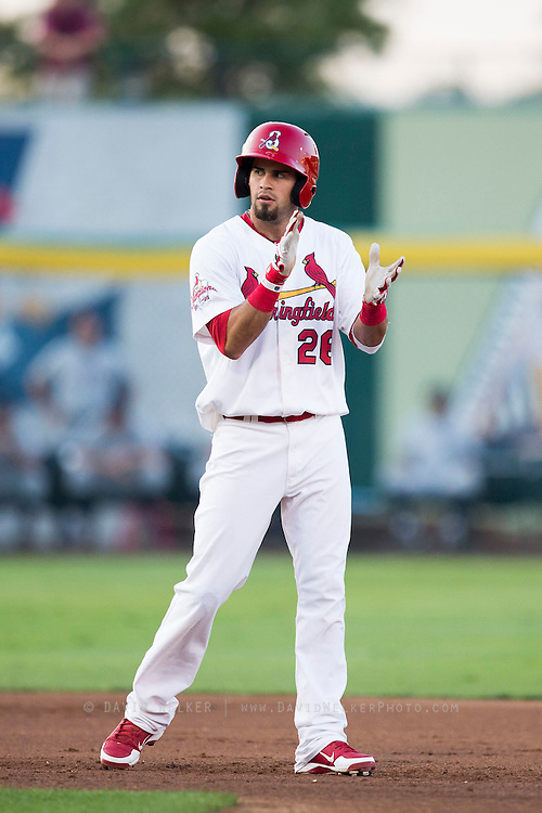 Luis Mateo (26) of the Springfield Cardinals claps his hands after hitting an RBI double during a game against the Northwest Arkansas Naturals at Hammons Field on August 20, 2013 in Springfield, Missouri. (David Welker)