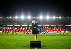 CARDIFF, WALES - Friday, October 11, 2013: Wales anthem singer Carrie Thompson performs before the 2014 FIFA World Cup Brazil Qualifying Group A match against Macedonia at the Cardiff City Stadium. (Pic by David Rawcliffe/Propaganda)
