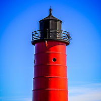 Milwaukee Pierhead Lighthouse photo in Milwaukee Wisconsin. The historic lighthouse is located on Lake Michigan one of the Great Lakes in the United States. Image is high resolution.