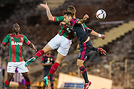 Portugal, FUNCHAL : Maritimo's German defender Patrick Bauer (L )  vies with Benfica's Brazilian forward Jonas  (R ) during Portuguese League football match Maritimo vs S.L. Benfica at Barreiros Stadium in Funchal on January  18, 2015. PHOTO/ GREGORIO CUNHA