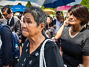 14 OCTOBER 2016 - BANGKOK, THAILAND:  People wait in line in front of the Sahathai Samakom Pavilion at the Grand Palace in Bangkok to pay respects to Bhumibol Adulyadej, the King of Thailand, who died Oct. 13, 2016. He was 88. His death comes after a period of failing health. With the king's death, the world's longest-reigning monarch is Queen Elizabeth II, who ascended to the British throne in 1952. Bhumibol Adulyadej, was born in Cambridge, MA, on 5 December 1927. He was the ninth monarch of Thailand from the Chakri Dynasty and is known as Rama IX. He became King on June 9, 1946 and served as King of Thailand for 70 years, 126 days. He was, at the time of his death, the world's longest-serving head of state and the longest-reigning monarch in Thai history.    PHOTO BY JACK KURTZ