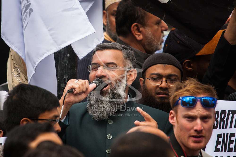 """London, April 18th 2014. as British right wing nationalists counter-demonstrate Anjem Choudary (centre) and his Islam4UK group protest at Regent's Park Mosque after Friday prayers, against """"Cameron's crusades"""" in the middle East."""