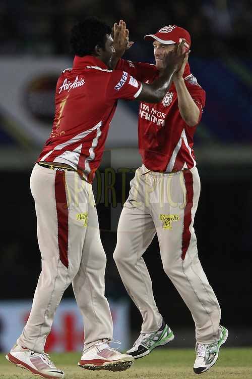 Thisara PERERA of the Kings XI Punjab celebrates the wicket ofElton CHIGUMBURA of the Barbados Tridents with George BAILEY (Captain) of the Kings XI Punjab  during match 5 of the Oppo Champions League Twenty20 between the Kings XI Punjab and the Barbados Tridents held at the Punjab Cricket Association Stadium, Mohali, India on the 20th September 2014<br /> <br /> Photo by:  Ron Gaunt / Sportzpics/ CLT20<br /> <br /> <br /> Image use is subject to the terms and conditions as laid out by the BCCI/ CLT20.  The terms and conditions can be downloaded here:<br /> <br /> http://sportzpics.photoshelter.com/gallery/CLT20-Image-Terms-and-Conditions-2014/G0000IfNJn535VPU/C0000QhhKadWcjYs