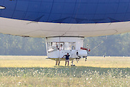 Montgomery, NY - Members of the ground crew helps control the MetLife blimp Snoopy Two at Orange County Airport on July 25, 2008.