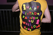Man with plastic letters reading 'Happy Birthday passion 4U with love xoxo' stuck on his T shirt, Passion, Emporium, Milton Keynes, UK, 2002