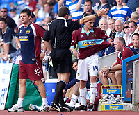 Photo: Daniel Hambury.<br /> Reading v Burnley. Coca Cola Championship.<br /> 29/08/2005.<br /> Burnley's Gareth O'Conner is told to leave the technical area by fourth official Mr. S. Tomlinson after being sent off late in the game.