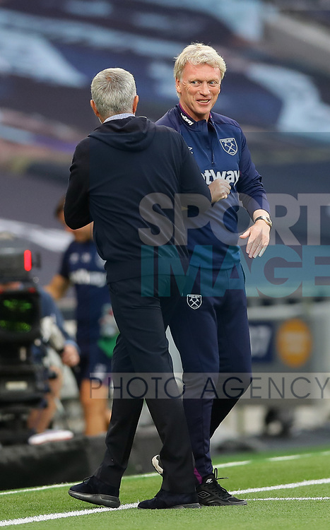 Jose Mourinho manager of Tottenham and David Moyes manager of West Ham United exchange elbow touches  during the Premier League match at the Tottenham Hotspur Stadium, London. Picture date: 23rd June 2020. Picture credit should read: David Klein/Sportimage