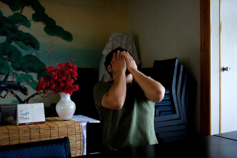 May 28, 2013 - Togura, Japan: A survivor from the devastating earthquake and tsunami that hit the east coast of Japan in 2011, reacts as he recounts the moment he saw his neighbours been dragged to see by the waves. (Paulo Nunes dos Santos)