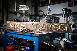 "© Licensed to London News Pictures. 04/05/2016. Birkenhead UK. Picture shows the Daniel Adamson's name plate during restoration work at the Canada Dock volunteer workshop. The Daniel Adamson steam boat has been bought back to operational service after a £5M restoration. The coal fired steam tug is the last surviving steam powered tug built on the Mersey and is believed to be the oldest operational Mersey built ship in the world. The ""Danny"" (originally named the Ralph Brocklebank) was built at Camel Laird ship yard in Birkenhead & launched in 1903. She worked the canal's & carried passengers across the Mersey & during WW1 had a stint working for the Royal Navy in Liverpool. The ""Danny"" was refitted in the 30's in an art deco style. Withdrawn from service in 1984 by 2014 she was due for scrapping until Mersey tug skipper Dan Cross bought her for £1 and the campaign to save her was underway. Photo credit: Andrew McCaren/LNP ** More information available here http://tinyurl.com/jsucxaq **"