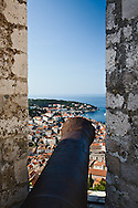 Cannon from Hvar Castle overlooking Hvar, and the Adriatic Sea, Hvar Island, Croatia