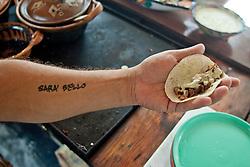 Il tatuaggio di Francesco che ne descrive l'ottimismo.